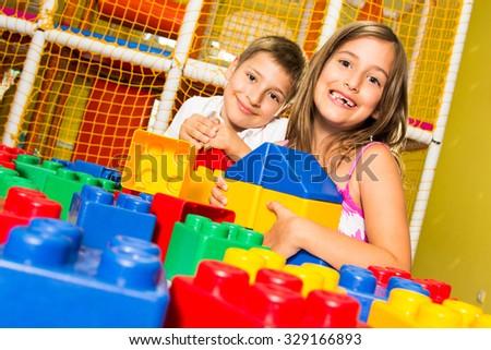 Children playing with blocks - stock photo