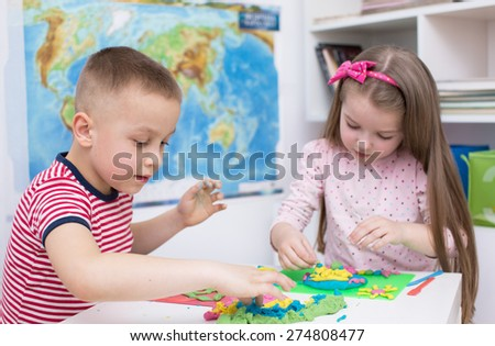 children Playing with Color Play Dough - stock photo