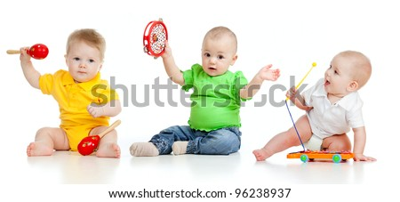 Children playing with musical toys. Isolated on white background - stock photo