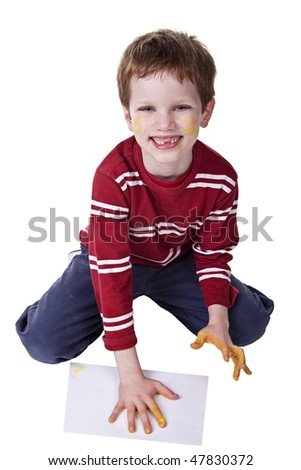 Children playing with paint, stamping his hand on a white sheet - stock photo