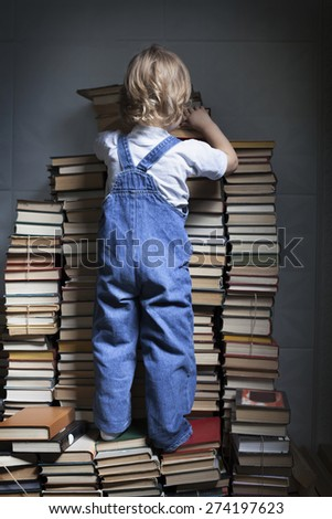 children reach for a book - stock photo