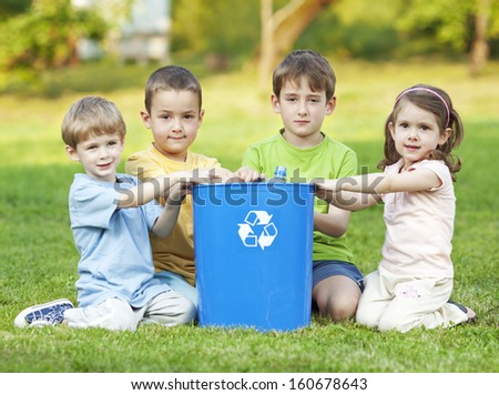 Children recycling in the yard - stock photo