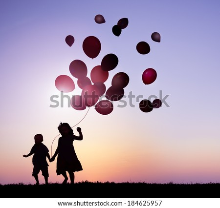 Children Running With Balloons at Sunset - stock photo