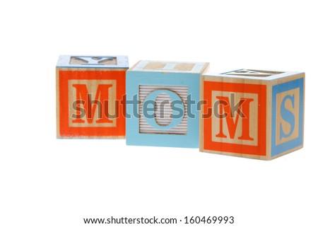 Children's Alphabet Blocks spelling the words mom  on white background on Education - stock photo
