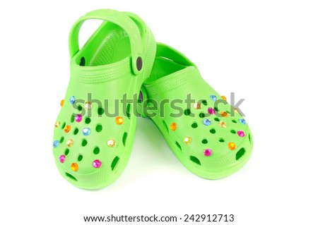 Children's beach slippers. Isolated over white - stock photo