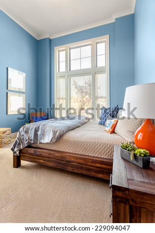 Children's Bedroom in Luxury Home, Vertical Orientation, with Large Windows and Colorful Decor - stock photo