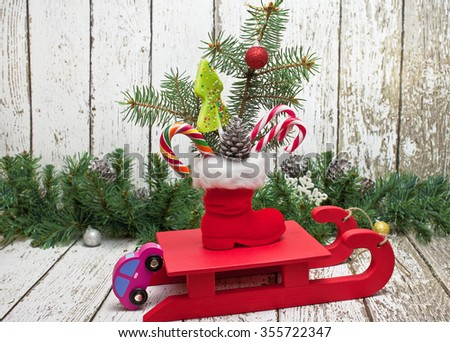 Children's Christmas gifts on a sled - stock photo