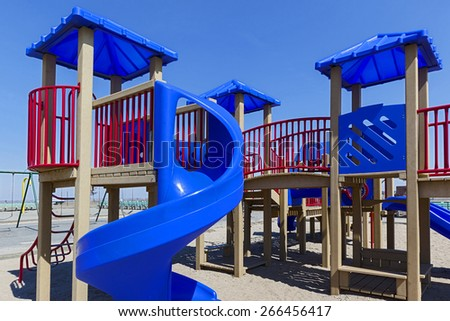 children's  colorful playground on blue sky summer outdoor - stock photo