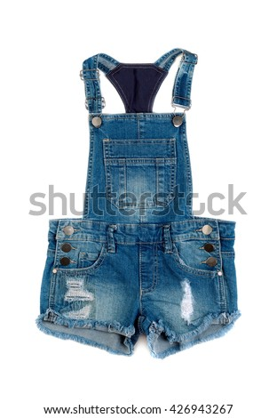 Children's denim shorts with suspenders. Isolate on white. - stock photo