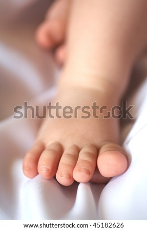 Children's foot on a soft light towel - stock photo