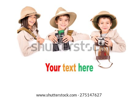 Children's group with safari clothes and gear over a white board - stock photo