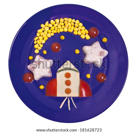 Children's meal astronaut. Rice with boiled sausages and vegetables. - stock photo