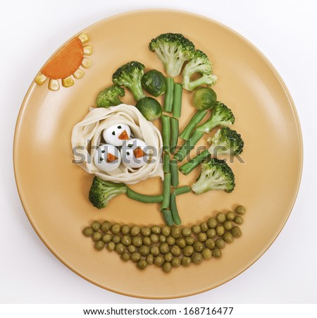 """Children's meal """"Tree with birds in the nest"""" - stock photo"""
