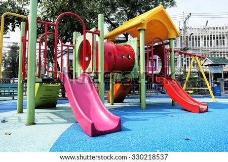 Children's playground at public park / Children's playground - stock photo