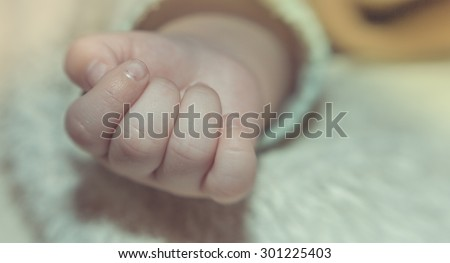 Children's plump hand close-up. - stock photo