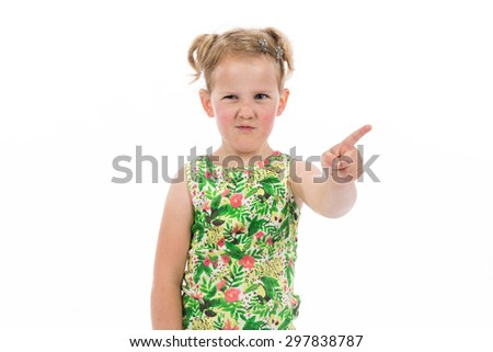 Children's real emotions. Cute frowning little girl showing something. - stock photo