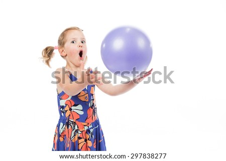 Children's real emotions. Little girl catching a ball isolated on white background. - stock photo