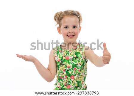 Children's real emotions. Little girl showing thumb up sign, isolated on white background. - stock photo