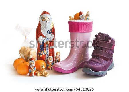 Children's shoes filled with candy for Nicholas day on the 6th December in Germany - stock photo
