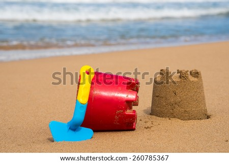 Children's toys at the beach on a sunny day - stock photo