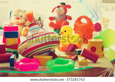 children's toys in the children's room summer day. care and upbringing of the child's conception. toned image. selective focus - stock photo