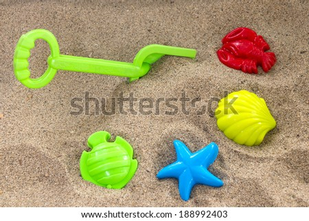 Children's toys on sand - stock photo