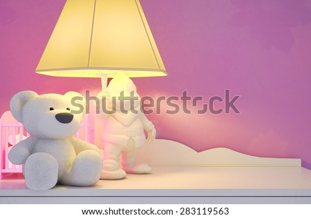 Children's toys, the lamp are located on a table. - stock photo