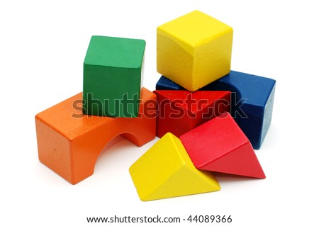 Children's wooden blocks photographed over white background - stock photo