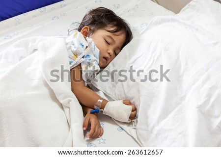 Children sick sleeping on the bed at the hospital - stock photo