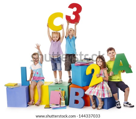 Children sitting at cube hand up. - stock photo
