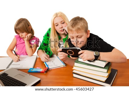 children sitting at the table isolated on white background - stock photo