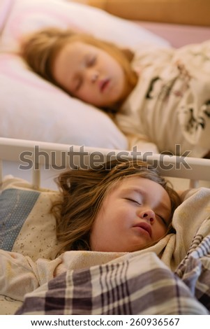 children sleeping girl in pajamas on the bed - stock photo
