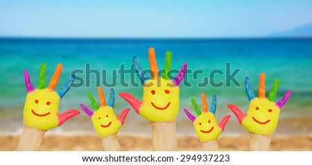 Children smiley hands on a beach background  - stock photo