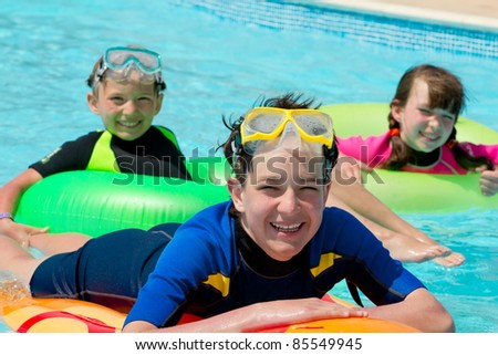 Children snorkeling in pool - stock photo