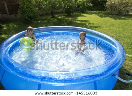 children swimming in the pool - stock photo
