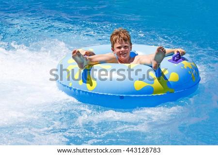 Children swimming in the pool - stock photo