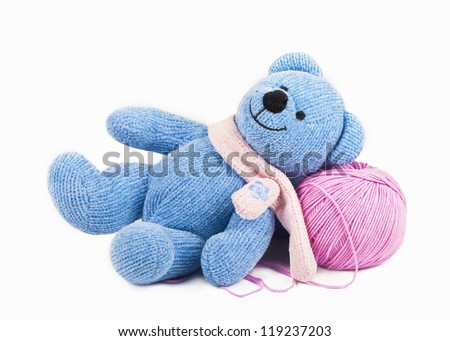 Children toy threads for knitting  lies isolated on a white background - stock photo
