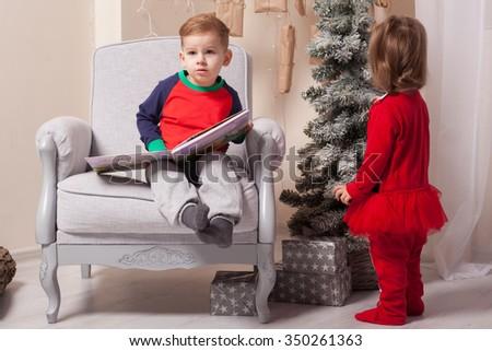 Children unpacking a presents - stock photo