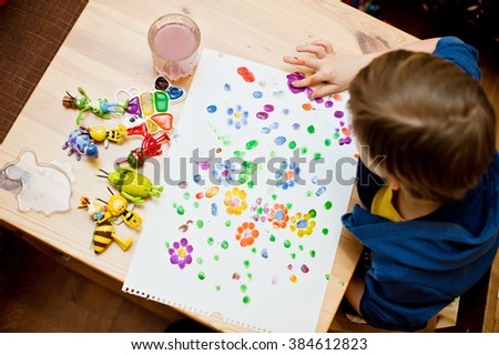 Children will draw a flower meadow - stock photo