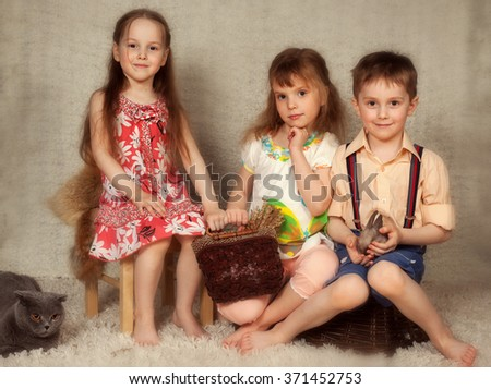 children with a rabbit for Easter  - stock photo