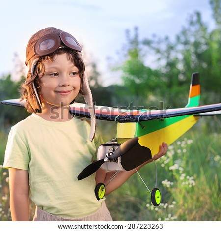 children with airplan toy outdoors (airplane is hand made not copyright) - stock photo