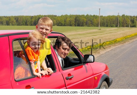children with father in red car - stock photo