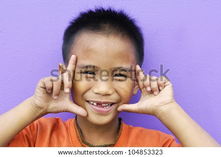 children with funny expression gesture open hand fingers-close up - stock photo