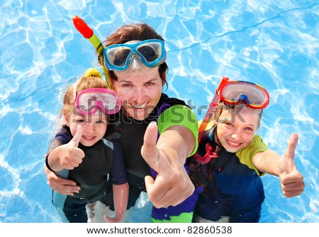 Children with mother  in swimming pool learning snorkeling. - stock photo