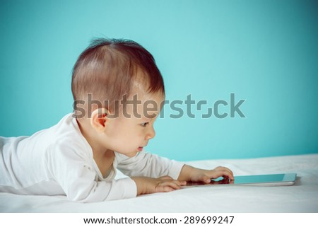 Children with Touch Screen Digital Tablet - stock photo