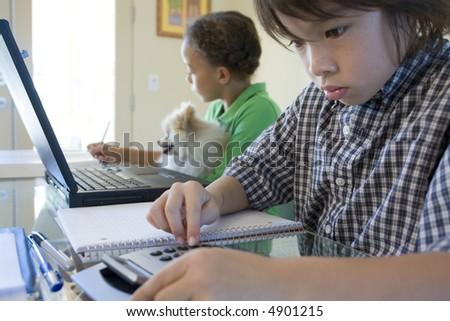 Children working on homework - stock photo