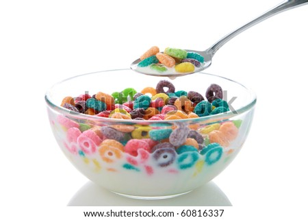 childrens breakfast cereal loops with milk. isolated on white - stock photo