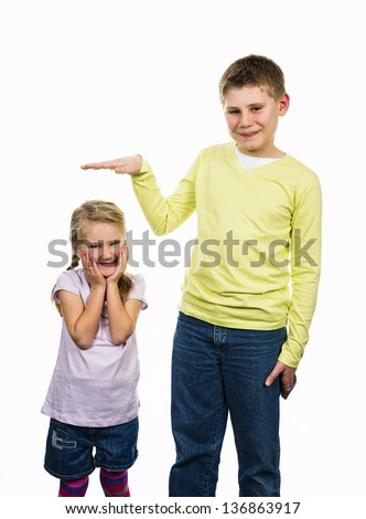 childrens girl and boy with a different size - stock photo