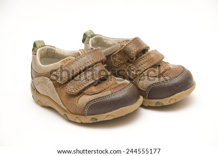 Childrens shoes isolated on a white background - stock photo