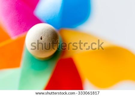 Childs Windmill multi coloured. - stock photo
